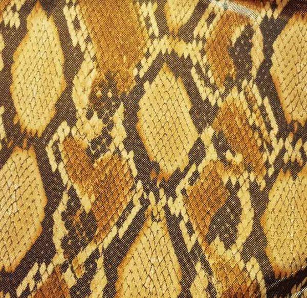 Tissu imprimé serpent poudré or